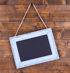 Rectangular chalkboard on wooden background