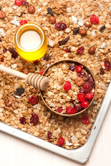 Granola with berries, honey and nuts. Top view. See series.