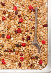 Granola with berries and nuts closeup