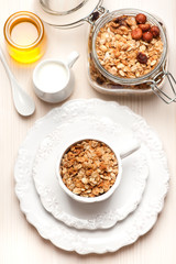 Granola with milk and honey. Healthy breakfast.