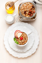 Granola with honey, fruit, nuts and milk. Healthy breakfast