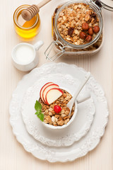 Granola muesli with honey and milk. Healthy breakfast.