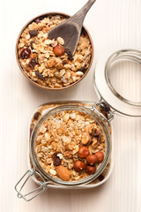 Granola with nuts on wooden background. Healthy breakfast.