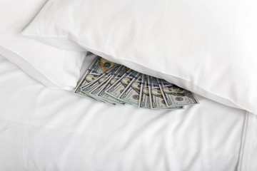 Hidden money under pillow close up