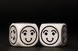 two emoticon dice with happy expression sketch