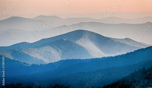 Panorama  of mountain ridges silhouettes - 70811441