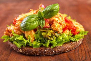 Wholegrain rye bread with lettuce and chicken