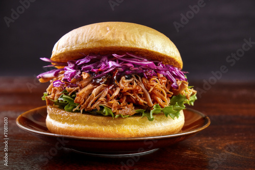 Pulled pork burger with red cabbage salad on plate