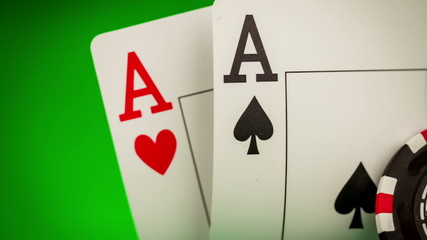 Stack of chips and two aces on the table on the green baize - po