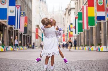 Little beautiful girls walking in Milan
