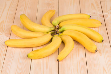Banana round shape as flower on wood.