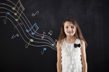 Female child playing who loves music