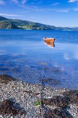Rowboat in Norwegian fjord