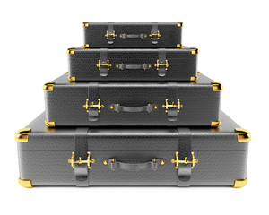 Stack of black leather suitcases