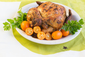 Roast chicken with  Sweet kumquat citrus fruits and parsley