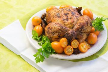 Roast chicken with  Sweet kumquat citrus fruits and parsley