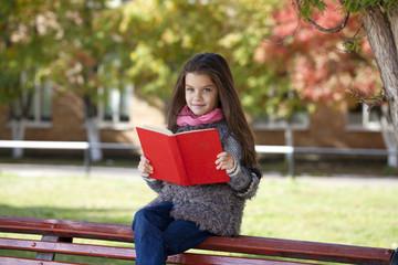 Beautifal little girl in the autumn park