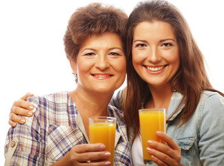 Two women with orange juice. Mother and Daughter