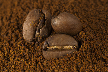 Closeup of coffee beans at roasted coffee heap