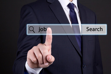 man in business suit searching job in internet