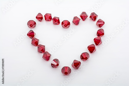 Macro Shot of A Collection Of Red Beads In Form Of A Heart - 70814691