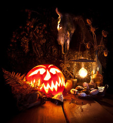 Halloween still life. Scary Halloween pumpkin, mushroom, candles