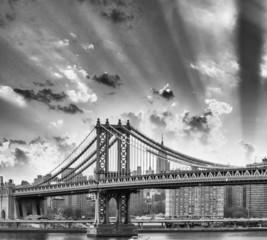 New York. Manhattan Bridge and city skyine at dusk