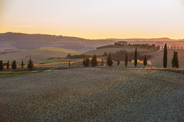 The setting sun over the valley of the Orcia in Tuscany, Italy
