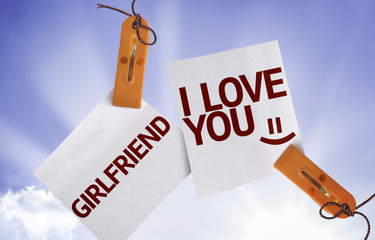 Girlfriend I Love You on Paper Note on sky background