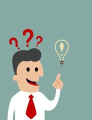 Businessman pointing toward a light bulb