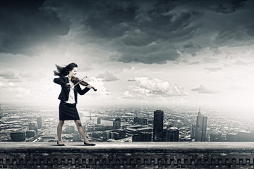 Businesswoman with violin