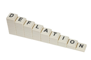 Stack of decreasing blocks showing the word DEFLATION isolated