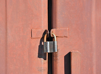 Rusty vintage lock on old garage gate