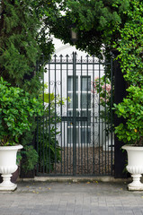 Vintage curved steel doors to the garden
