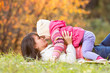 beautiful mother with kid girl outdoors in fall