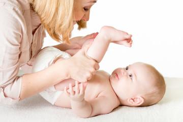 mother doing gymnastics her baby infant
