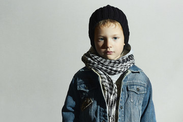 fashionable little boy in scarf.jeans.winter fashion kids.child
