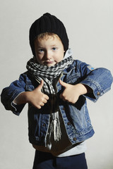 fashionable little boy in scarf.winter fashion.funny child