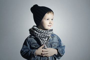 little boy in scarf and jeans.winter fashion kids.funny child