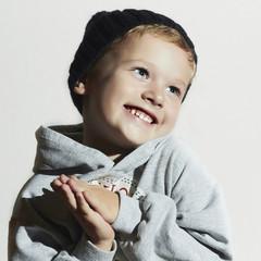 happy joyful beautiful little boy.fashionable smiling child