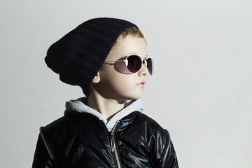 Fashionable child boy in sunglasses.Little boy.Autumn-Winter