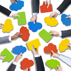 Group of Hands Holding Speech Bubbles