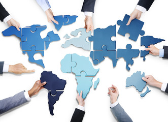 Business People with World Jigsaw Puzzle Forming