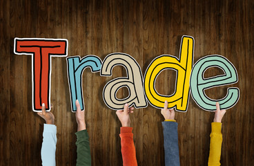 Group of Hands Holding Word Trade