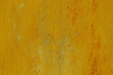 Yellow cracked paint on rusty background