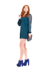 Attractive young woman in turquoise dress