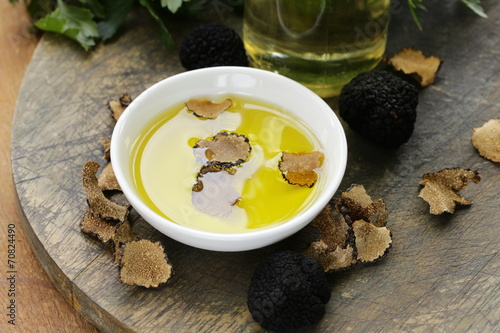 Papiers peints Condiment Olive oil flavored with black truffle on a wooden table