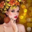 Beautiful woman with tree autmn ornament in head