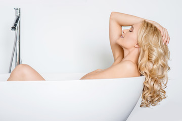 Beautiful woman relaxing in a bath tub