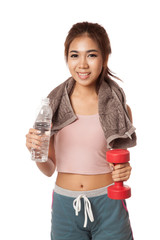 Happy Workout Asian girl with bottle of water and Dumbbell